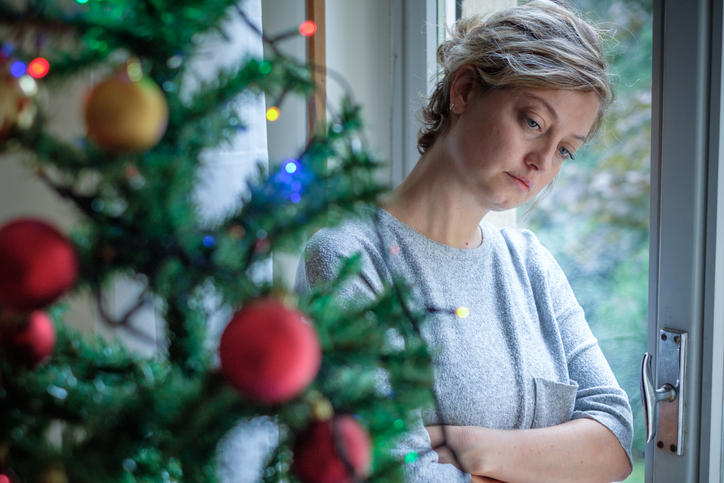 Woman feeling alone during christmas holiday - The Law Offices of Jane M. Randall, P.A. - Family Law, Family Mediation, Real Estate Attorney | in York County, Chester County, Lancaster County